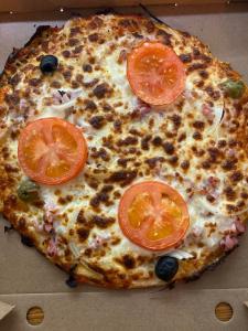 La pizza Paysanne du restaurant pizzeria grill le moulin à cherbourg